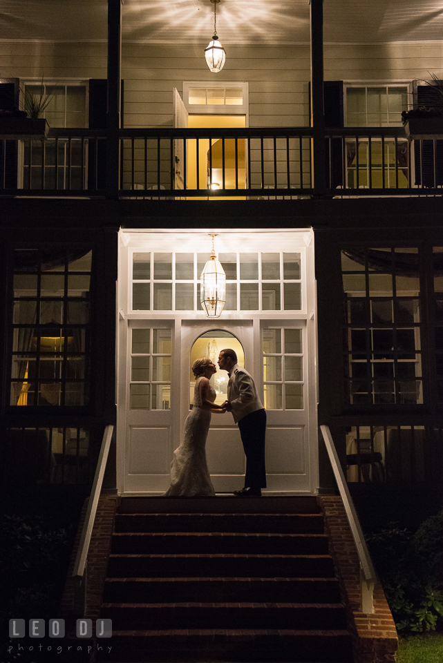 Kent Manor Inn evening shot of Bride and Groom silhouette in back of the hotel photo by Leo Dj Photography