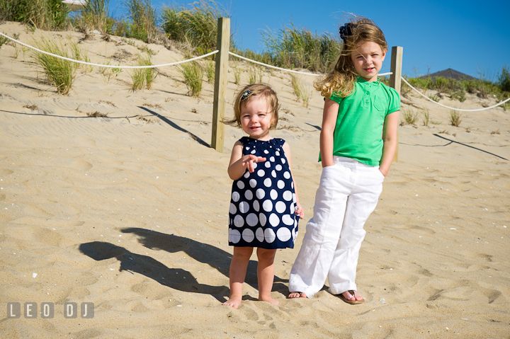 Two toddler girls posing on the beach. Ocean City, Maryland Eastern Shore candid children and family lifestyle photo session by photographers of Leo Dj Photography. http://leodjphoto.com
