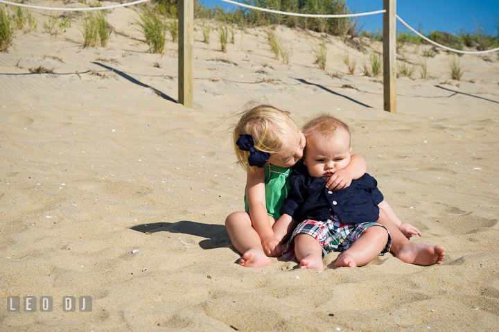 Toddler girl hugging his baby brother. Ocean City, Maryland Eastern Shore candid children and family lifestyle photo session by photographers of Leo Dj Photography. http://leodjphoto.com