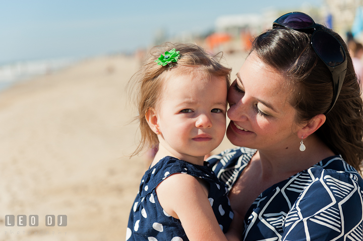 Mother cuddling her little girl. Ocean City, Maryland Eastern Shore candid children and family lifestyle photo session by photographers of Leo Dj Photography. http://leodjphoto.com