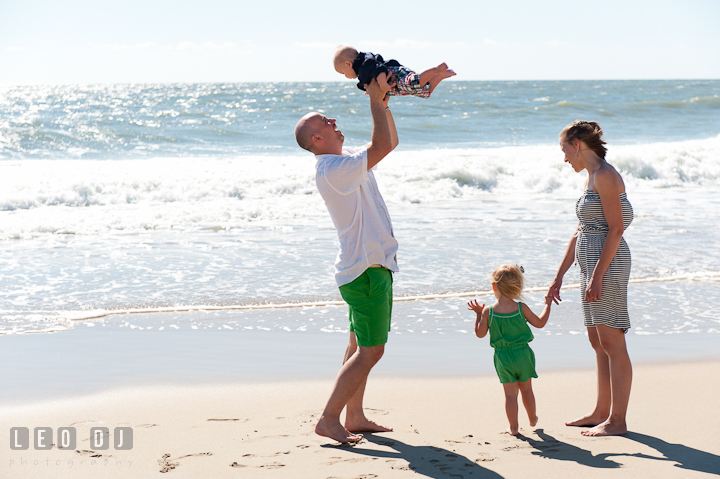 Family playing by the water on the beach. Ocean City, Maryland Eastern Shore candid children and family lifestyle photo session by photographers of Leo Dj Photography. http://leodjphoto.com