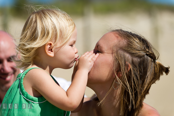 Girl trying to kiss Mommy's nose. Ocean City, Maryland Eastern Shore candid children and family lifestyle photo session by photographers of Leo Dj Photography. http://leodjphoto.com