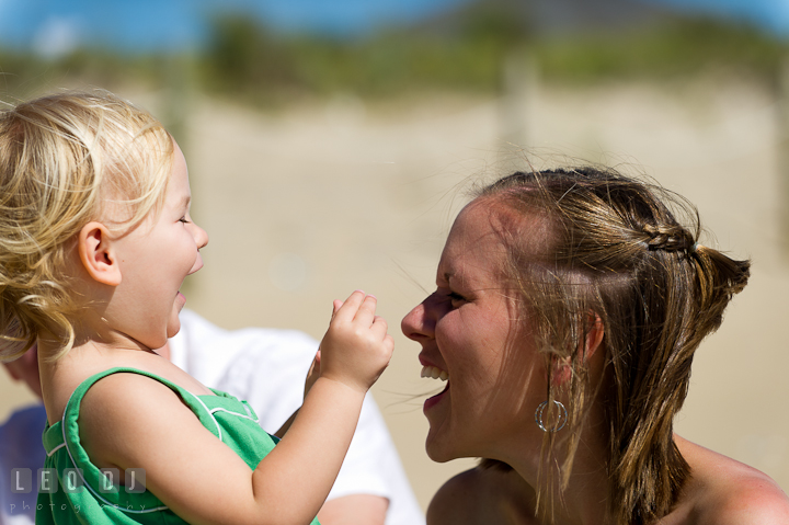 Girl laughing with Mommy. Ocean City, Maryland Eastern Shore candid children and family lifestyle photo session by photographers of Leo Dj Photography. http://leodjphoto.com