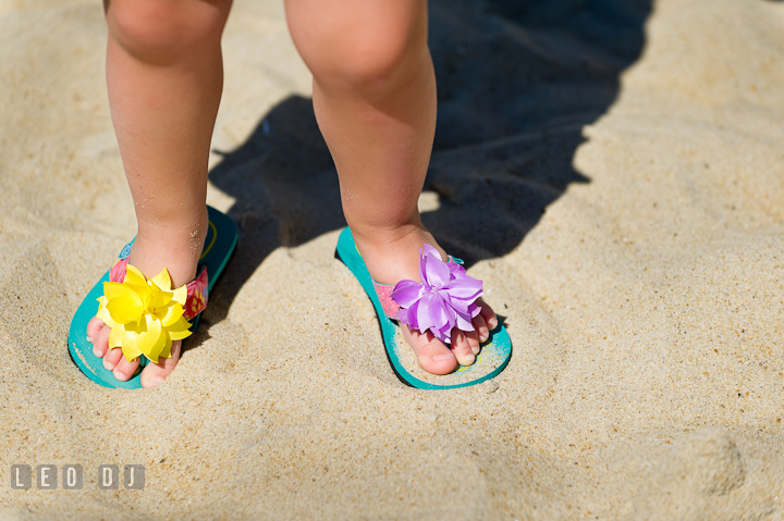 Little girls wearing cute flip flops. Ocean City, Maryland Eastern Shore candid children and family lifestyle photo session by photographers of Leo Dj Photography. http://leodjphoto.com