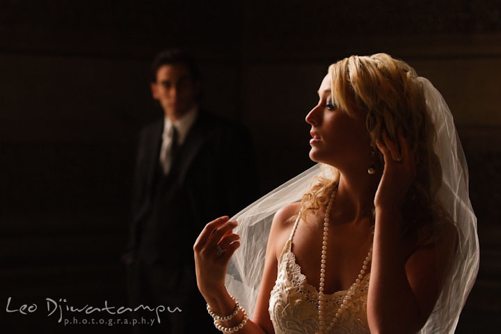 Bride playing with veil, groom looking from a distance. Wedding bridal portrait photo workshop with Cliff Mautner. Images by Leo Dj Photography