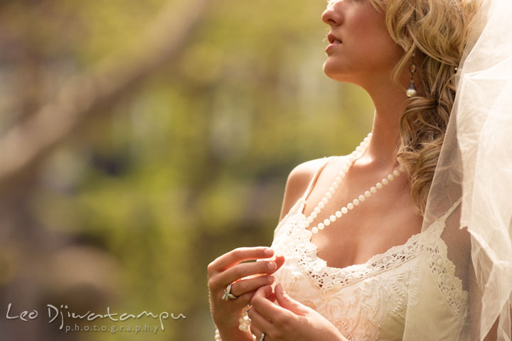 Bride playing with her necklace or jewelery. Wedding bridal portrait photo workshop with Cliff Mautner. Images by Leo Dj Photography