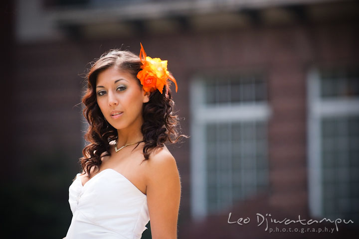 Bride with orange flower on hair, posing for the camera. Wedding bridal portrait photo workshop with Cliff Mautner. Images by Leo Dj Photography