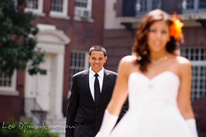Groom approaching clueless bride during first glance. Wedding bridal portrait photo workshop with Cliff Mautner. Images by Leo Dj Photography
