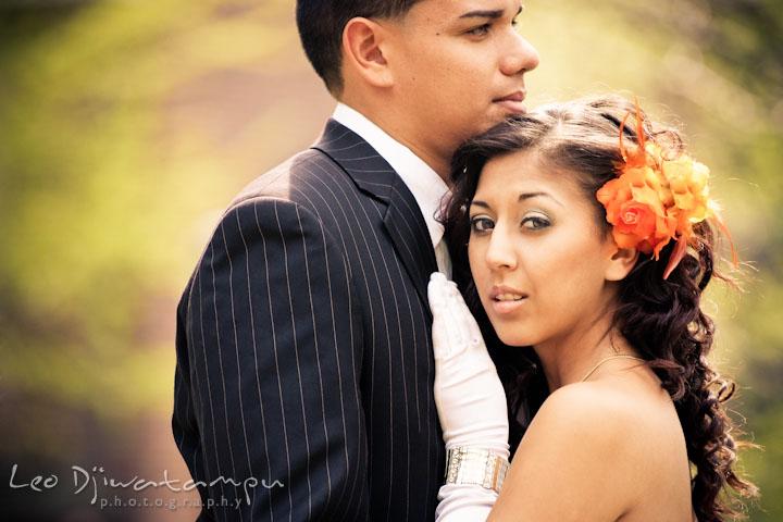 Bride with orange flower cuddling on groom's chest. Wedding bridal portrait photo workshop with Cliff Mautner. Images by Leo Dj Photography