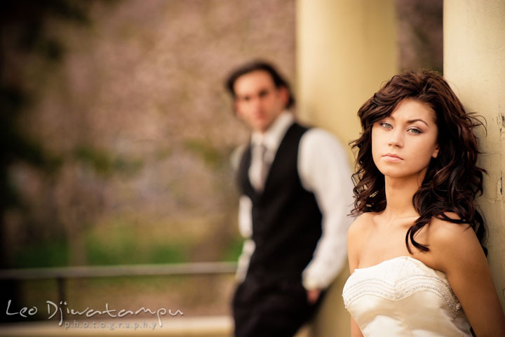Bride posing and groom looking in the background. Wedding bridal portrait photo workshop with Cliff Mautner. Images by Leo Dj Photography