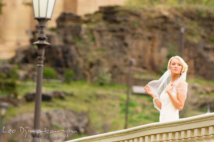Bride playing with her veil by a lamppost. Wedding bridal portrait photo workshop with Cliff Mautner. Images by Leo Dj Photography