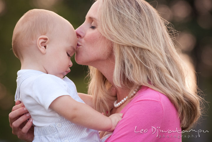 Mother kissed her toddler son. Edgewater, Annapolis, Eastern Shore Maryland fun and candid children and family lifestyle photo session by photographers of Leo Dj Photography.