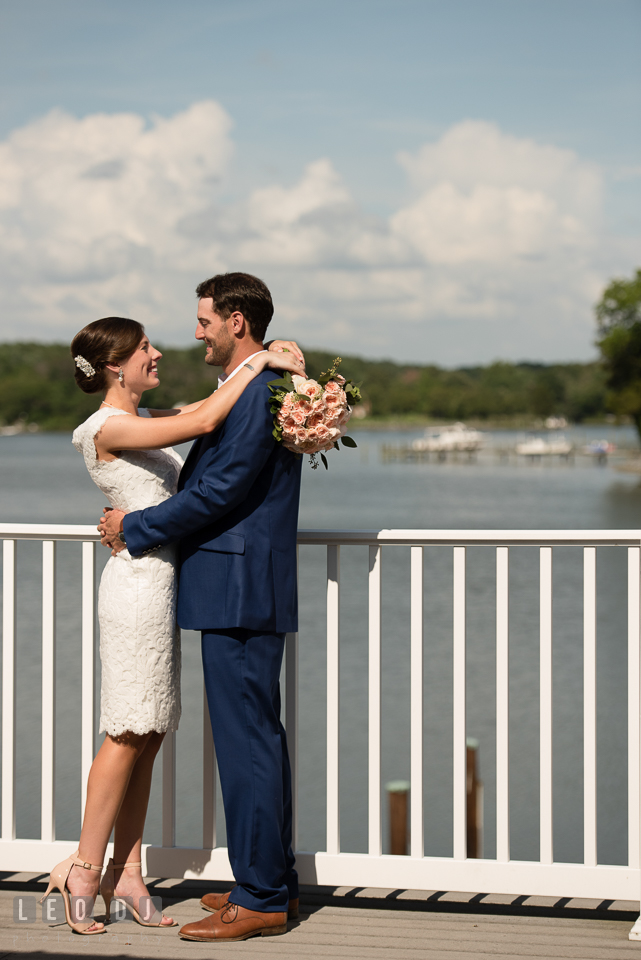 Bride and Groom hugging on the rooftop deck overlooking at the water. The Oaks Waterfront Inn wedding, St Michaels, Eastern Shore, Maryland, by wedding photographers of Leo Dj Photography. http://leodjphoto.com