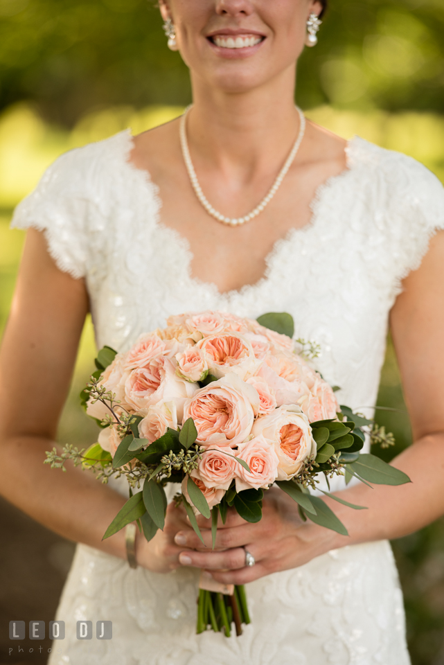 Bride holding wedding flower bouquet by florist Sophie's Poseys. The Oaks Waterfront Inn wedding, St Michaels, Eastern Shore, Maryland, by wedding photographers of Leo Dj Photography. http://leodjphoto.com