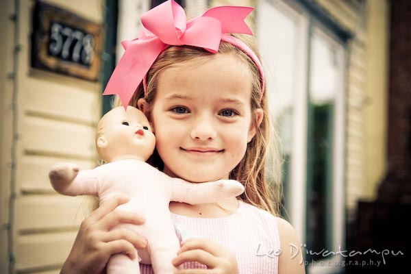 girl, pink ribbon, and her doll. Children family reunion birthday photography Tilghman Island Annapolis Kent Island Eastern Shore MD