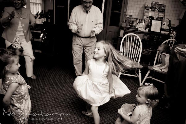 girl and family dancing. Children family reunion birthday photography Tilghman Island Annapolis Kent Island Eastern Shore MD