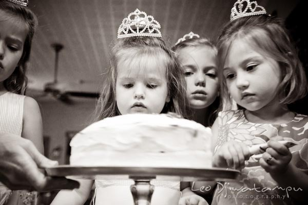 girls admiring their cake. Children family reunion birthday photography Tilghman Island Annapolis Kent Island Eastern Shore MD