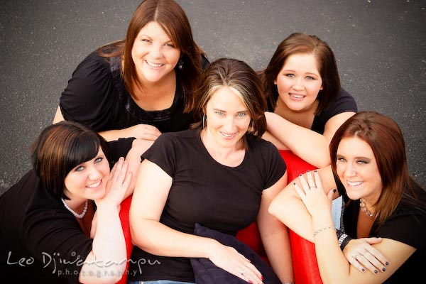 Five ladies posing on/by chair, looking up. Commercial work photography Annapolis Eastern Shore MD Washington DC