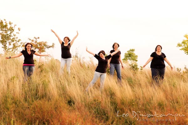 Girls, ladies raising arms posing in tall grass, meadow. Commercial work photography Annapolis Eastern Shore MD Washington DC