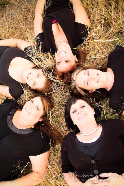 Girls, ladies laying on grassy-ground making circle, smiling. Commercial work photography Annapolis Eastern Shore MD Washington DC