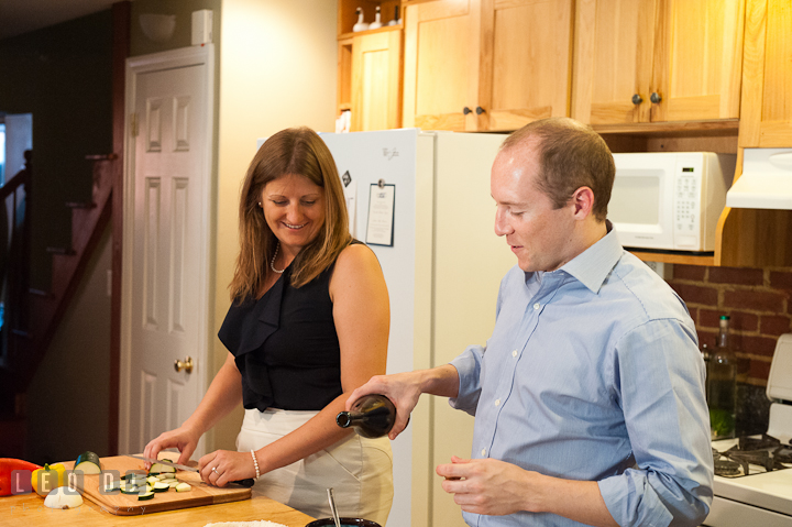 Engaged guy poured olive oil on egg. His fiancée looking. Engagement photo session at town home near Federal Hill Baltimore Maryland by wedding photographers of Leo Dj Photography (http://leodjphoto.com)