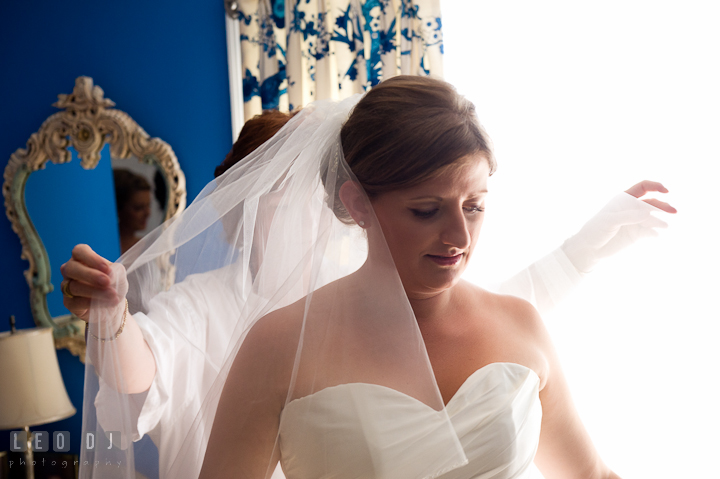 Mother of Bride lift up daughter's veil. Getting ready and ceremony wedding photos at private estate at Preston, Easton, Eastern Shore, Maryland by photographers of Leo Dj Photography. http://leodjphoto.com