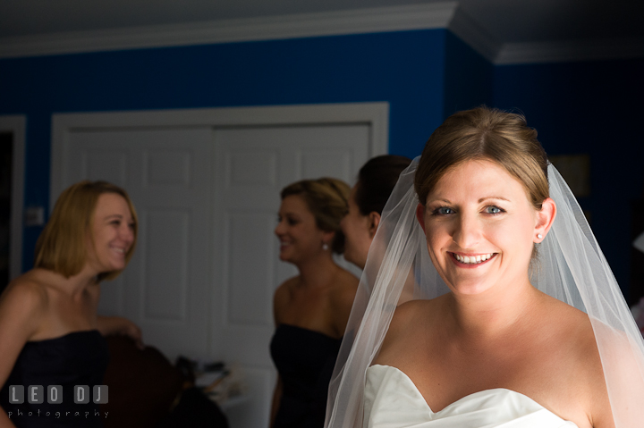 Bride smiling while Bridesmaid and Maid of Honor are talking. Getting ready and ceremony wedding photos at private estate at Preston, Easton, Eastern Shore, Maryland by photographers of Leo Dj Photography. http://leodjphoto.com