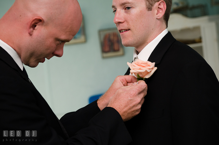 Groomsmen helping Groom put on boutonniere. Getting ready and ceremony wedding photos at private estate at Preston, Easton, Eastern Shore, Maryland by photographers of Leo Dj Photography. http://leodjphoto.com