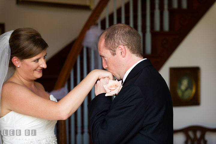 Groom kissed Bride's hand during first glance. Getting ready and ceremony wedding photos at private estate at Preston, Easton, Eastern Shore, Maryland by photographers of Leo Dj Photography. http://leodjphoto.com