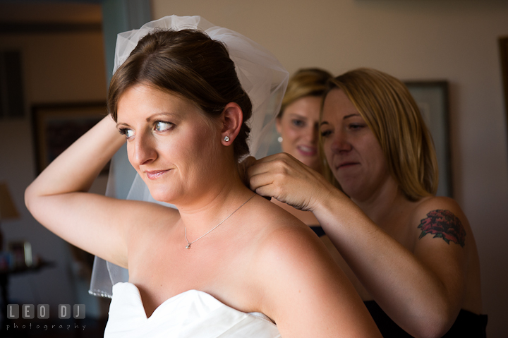 Bridesmaid helping Bride put on necklace. Getting ready and ceremony wedding photos at private estate at Preston, Easton, Eastern Shore, Maryland by photographers of Leo Dj Photography. http://leodjphoto.com