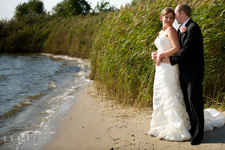 Bride and Groom cuddling on the beach. Getting ready and ceremony wedding photos at private estate at Preston, Easton, Eastern Shore, Maryland by photographers of Leo Dj Photography. http://leodjphoto.com