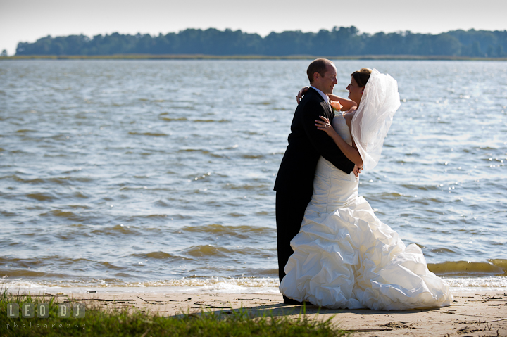 Bride and Groom hugging on the beach. Getting ready and ceremony wedding photos at private estate at Preston, Easton, Eastern Shore, Maryland by photographers of Leo Dj Photography. http://leodjphoto.com