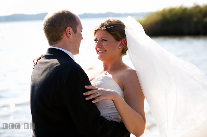 Bride and Groom on the beach looking at each other. Getting ready and ceremony wedding photos at private estate at Preston, Easton, Eastern Shore, Maryland by photographers of Leo Dj Photography. http://leodjphoto.com