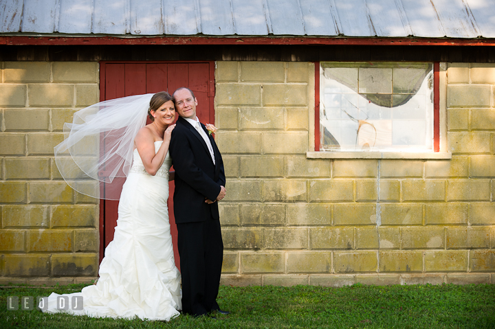 Bride and Groom posing together by a red door. Getting ready and ceremony wedding photos at private estate at Preston, Easton, Eastern Shore, Maryland by photographers of Leo Dj Photography. http://leodjphoto.com