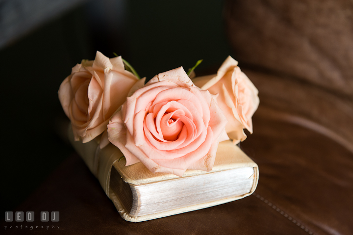 Bride's bouquet of roses on a Bible. Getting ready and ceremony wedding photos at private estate at Preston, Easton, Eastern Shore, Maryland by photographers of Leo Dj Photography. http://leodjphoto.com