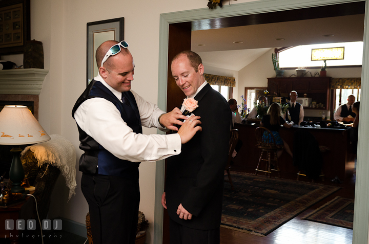 Best Man helping Groom put in handkerchief. Getting ready and ceremony wedding photos at private estate at Preston, Easton, Eastern Shore, Maryland by photographers of Leo Dj Photography. http://leodjphoto.com