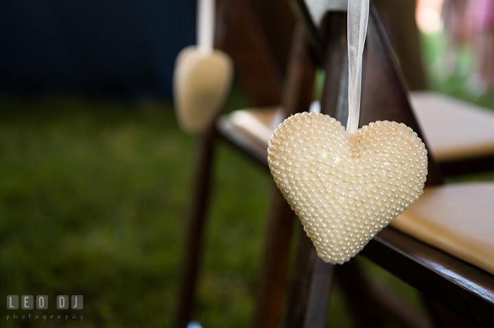 Heart decorations hanging on Bride and Groom's chairs. Getting ready and ceremony wedding photos at private estate at Preston, Easton, Eastern Shore, Maryland by photographers of Leo Dj Photography. http://leodjphoto.com