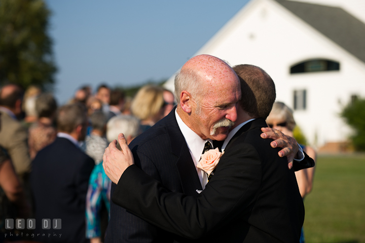 Father of the Groom hugging son. Getting ready and ceremony wedding photos at private estate at Preston, Easton, Eastern Shore, Maryland by photographers of Leo Dj Photography. http://leodjphoto.com