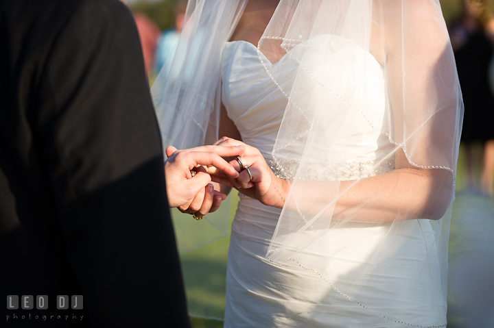 Bride and Groom exchanging wedding rings. Getting ready and ceremony wedding photos at private estate at Preston, Easton, Eastern Shore, Maryland by photographers of Leo Dj Photography. http://leodjphoto.com