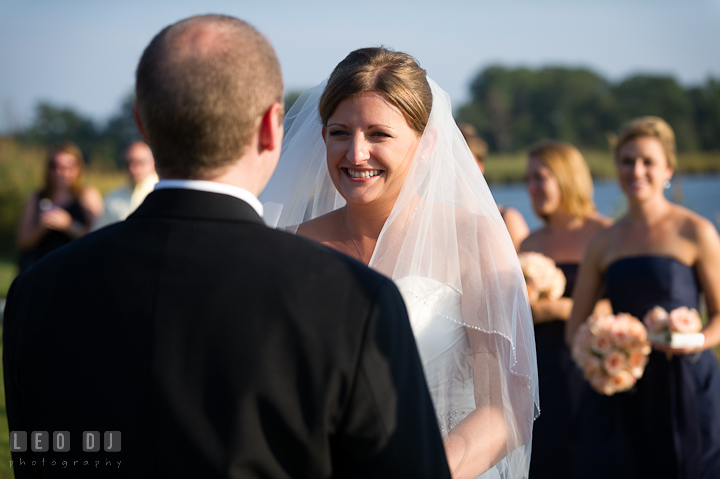Bride smiling to Groom while reading vow. Getting ready and ceremony wedding photos at private estate at Preston, Easton, Eastern Shore, Maryland by photographers of Leo Dj Photography. http://leodjphoto.com