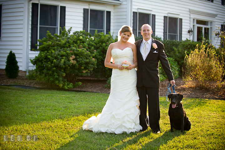 Bride and Groom posing together with their pet dog. Reception party wedding photos at private estate at Preston, Easton, Eastern Shore, Maryland by photographers of Leo Dj Photography. http://leodjphoto.com