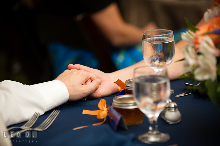 Bride and Groom holding hands at the sweetheart table. Reception party wedding photos at private estate at Preston, Easton, Eastern Shore, Maryland by photographers of Leo Dj Photography. http://leodjphoto.com