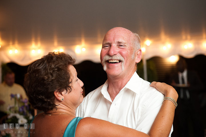 Father and Mother of Groom dancing and laughing. Reception party wedding photos at private estate at Preston, Easton, Eastern Shore, Maryland by photographers of Leo Dj Photography. http://leodjphoto.com