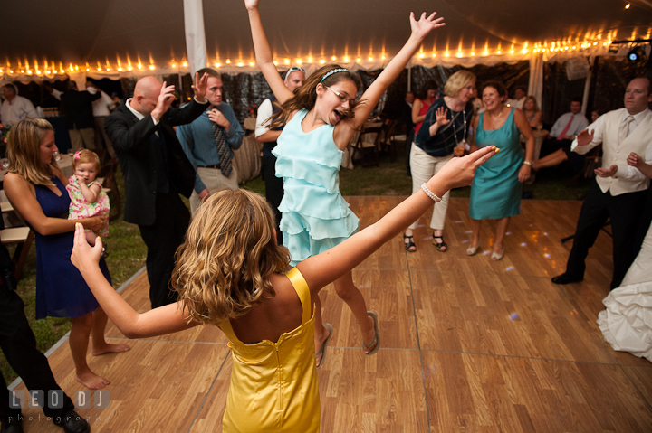 Two little girls dancing and jumping. Reception party wedding photos at private estate at Preston, Easton, Eastern Shore, Maryland by photographers of Leo Dj Photography. http://leodjphoto.com