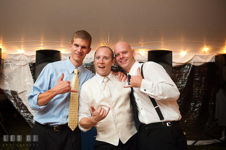 Groom and guests doing the metal hand gesture. Reception party wedding photos at private estate at Preston, Easton, Eastern Shore, Maryland by photographers of Leo Dj Photography. http://leodjphoto.com