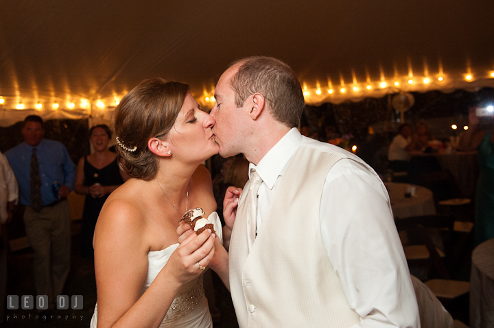 Bride and Groom kissing after feeding cupcakes to each other. Reception party wedding photos at private estate at Preston, Easton, Eastern Shore, Maryland by photographers of Leo Dj Photography. http://leodjphoto.com