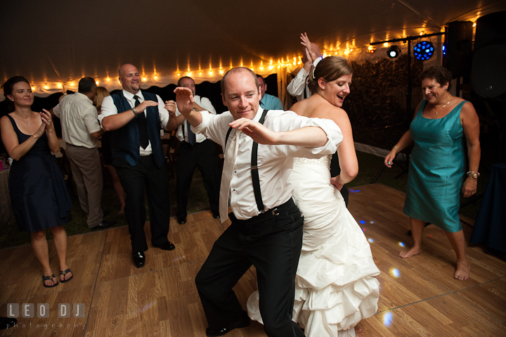 Bride and Groom dancing and rubbing their buttocks. Reception party wedding photos at private estate at Preston, Easton, Eastern Shore, Maryland by photographers of Leo Dj Photography. http://leodjphoto.com