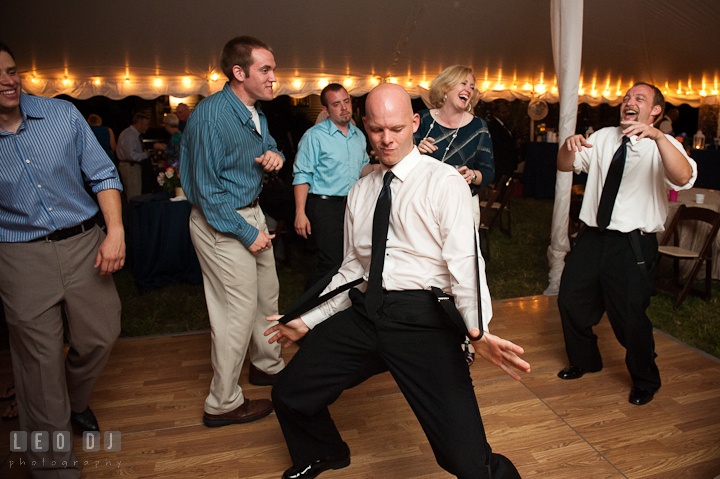 Groomsmen doing silly dance while other guests laughing. Reception party wedding photos at private estate at Preston, Easton, Eastern Shore, Maryland by photographers of Leo Dj Photography. http://leodjphoto.com