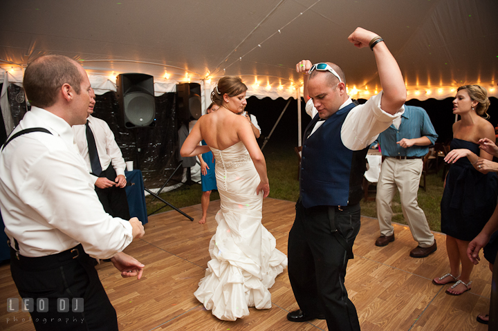 Best Man doing silly dance with Bride and Groom. Reception party wedding photos at private estate at Preston, Easton, Eastern Shore, Maryland by photographers of Leo Dj Photography. http://leodjphoto.com