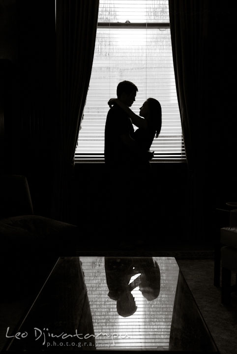 Engaged couple embracing by the window. Tremont Plaza Hotel and Grand Historic Venue Baltimore Pre-wedding Engagement Photo Session by wedding photographers Leo Dj Photography